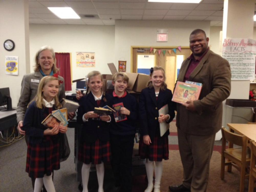 Wonderland Booksavers with Martha Lord, director of Pequot Library and Mr. White, headmaster of New Beginnings Family Academy, a book recipient