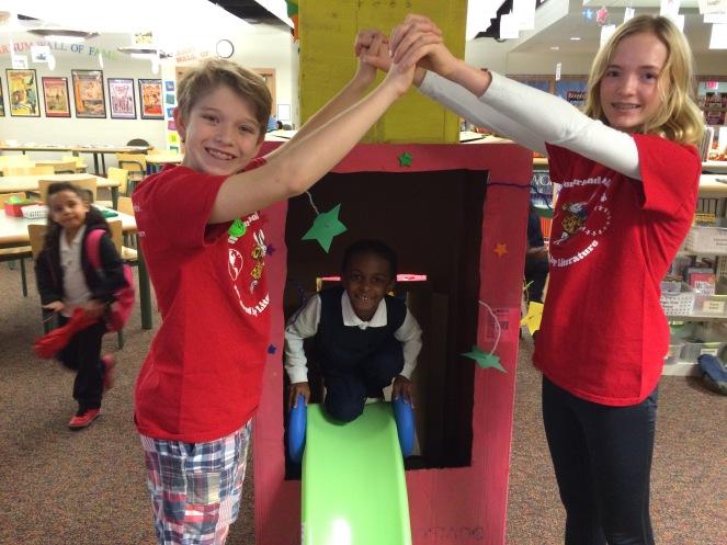 a first-grader at Barnum School slides through the Sneetch machine