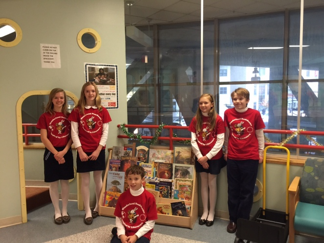 posing with some of our books donated to Tufts Floating Hospital for Children
