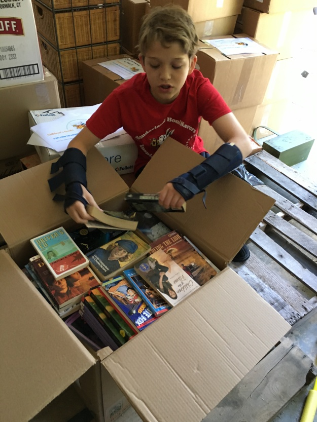 Brooks Morgan sorting books