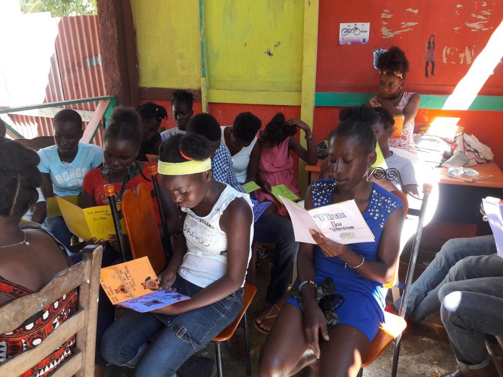 Haitian kids reading books WBS 1