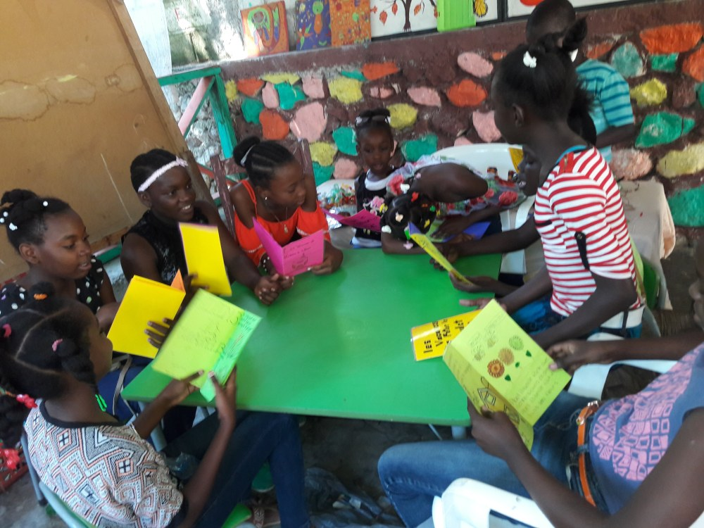 Haitian kids reading books WBS 2