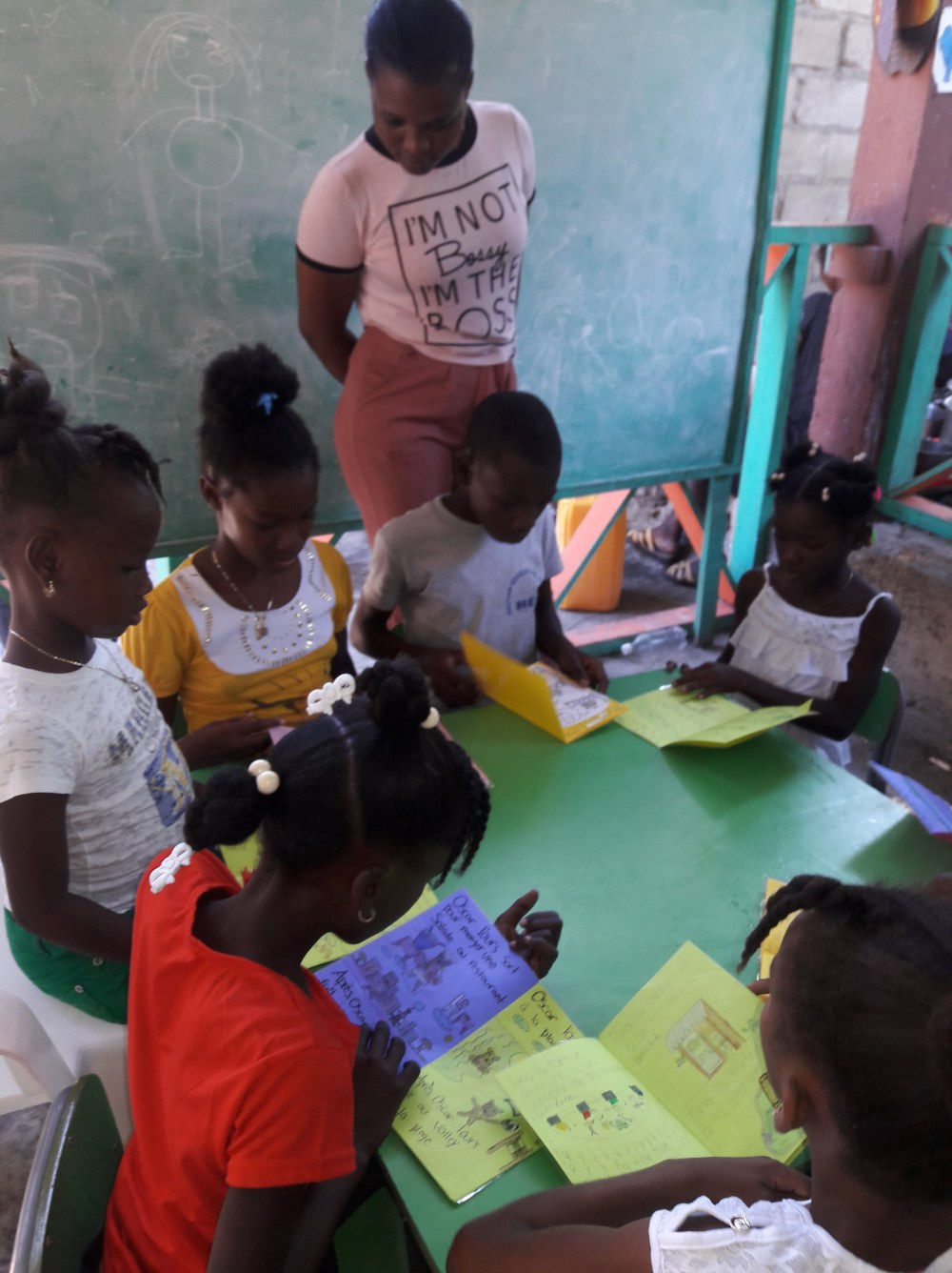 Haitian kids reading books WBS 3